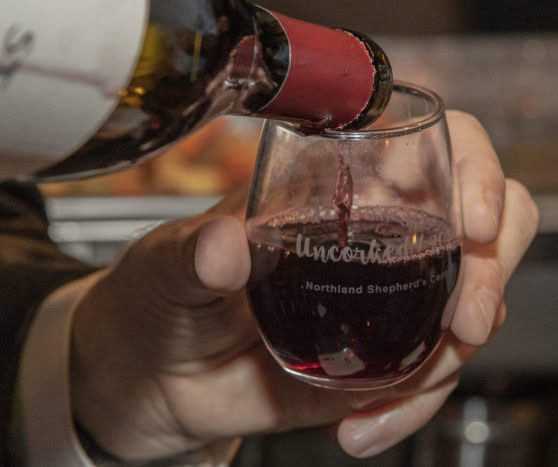 Wine being poured into a glass